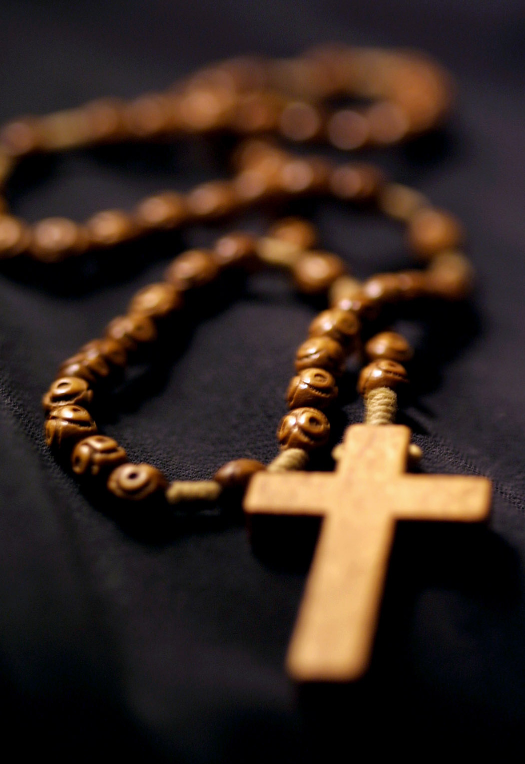 "Pope John Paul II made an appeal to people around the world to pray the rosary daily to help protect humanity from the ""evil scourge"" of terrorism. The rosary, the most common of Catholic devotional prayers, consists of reciting Hail Marys, the Lord's Prayer and the Doxology on a string of beads. (CNS photo by Nancy Wiechec) (Oct. 1, 2001) See POPE-ROSARY Oct. 1, 2001."